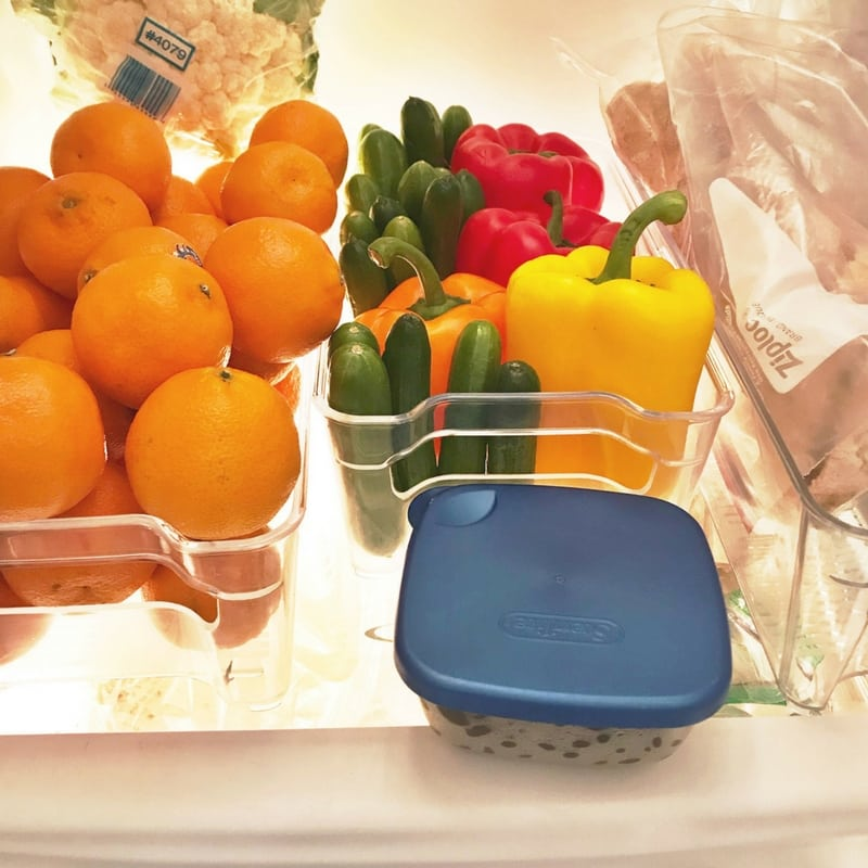 fruit and vegetables in containers to keep the fridge organized.