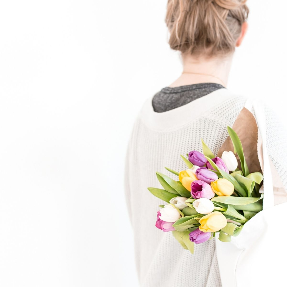 Holding tulips in a bag