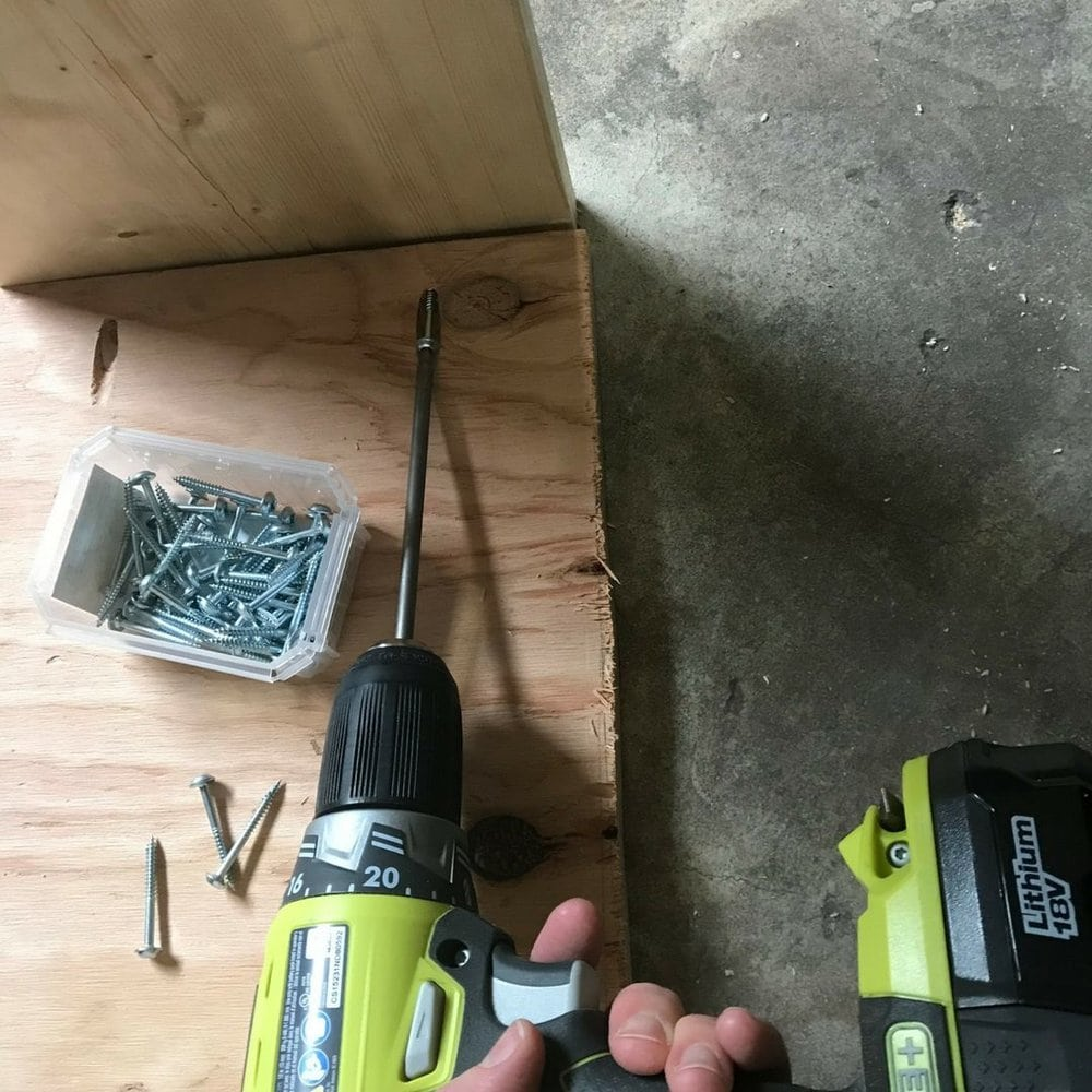 Attaching pocket hole screws with a power drill.