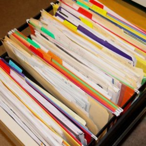 Filing paperwork and creating a filing system will help you create a paper clutter system.