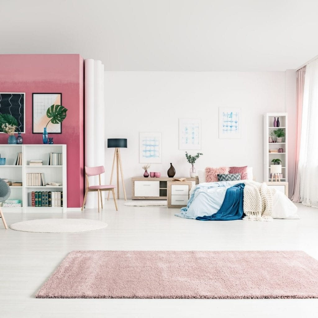 pink rug in a room