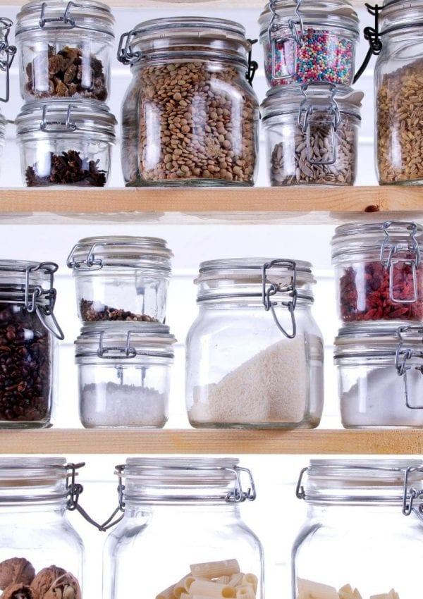 organized pantry with glass jars