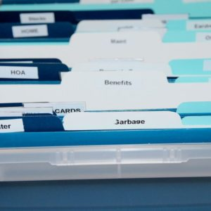 Set up a filing system to organize your paperwork.  This is a simple DIY paper clutter system will keep you organized.