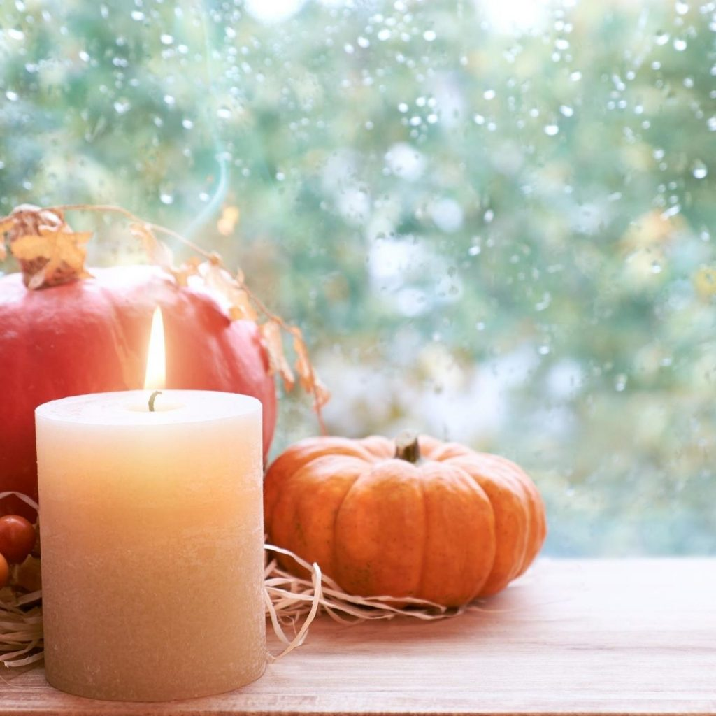 pumpkins and a lit candle