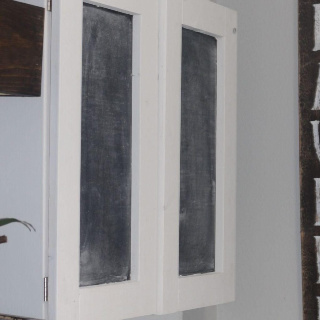 DIY wall mounted cabinet hanging in a laundry room