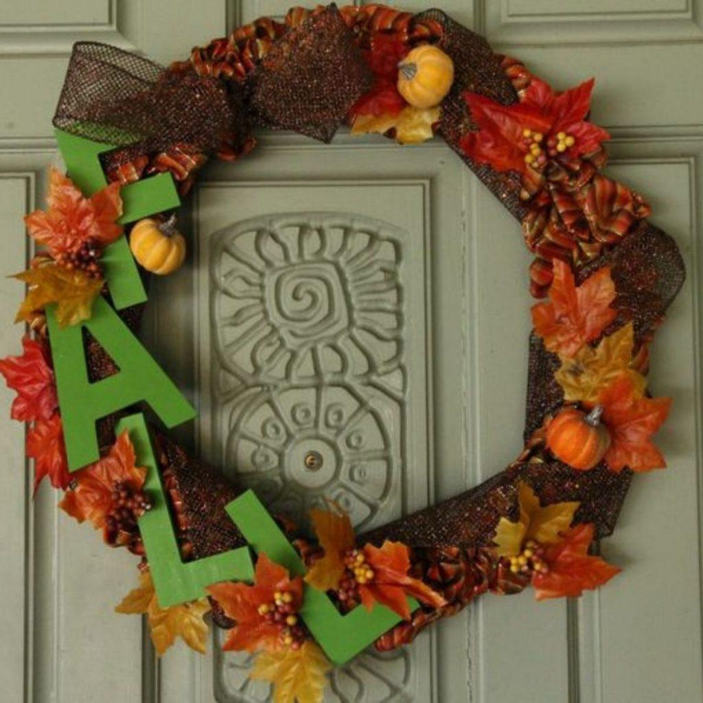 fall wreath hanging on a door