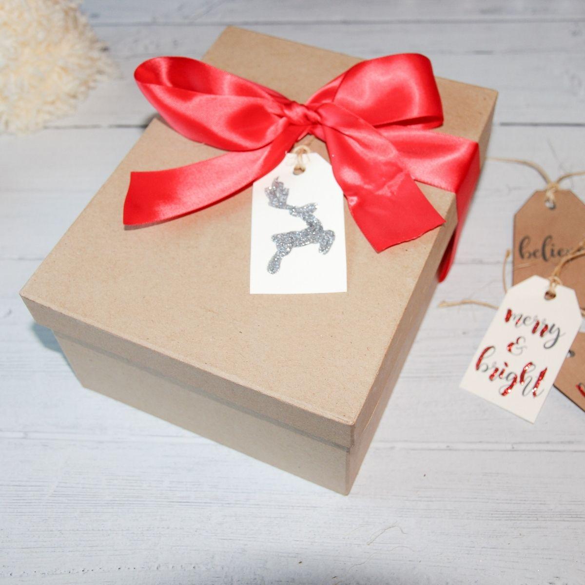 printable Christmas gift tag on a gift with a bow