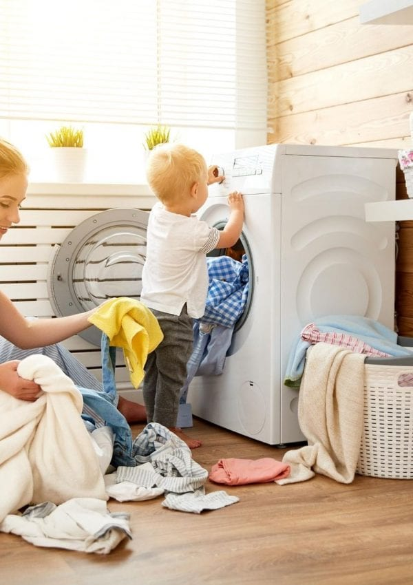 mother and child doing laundry