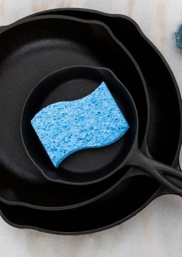 cast iron pan with a sponge