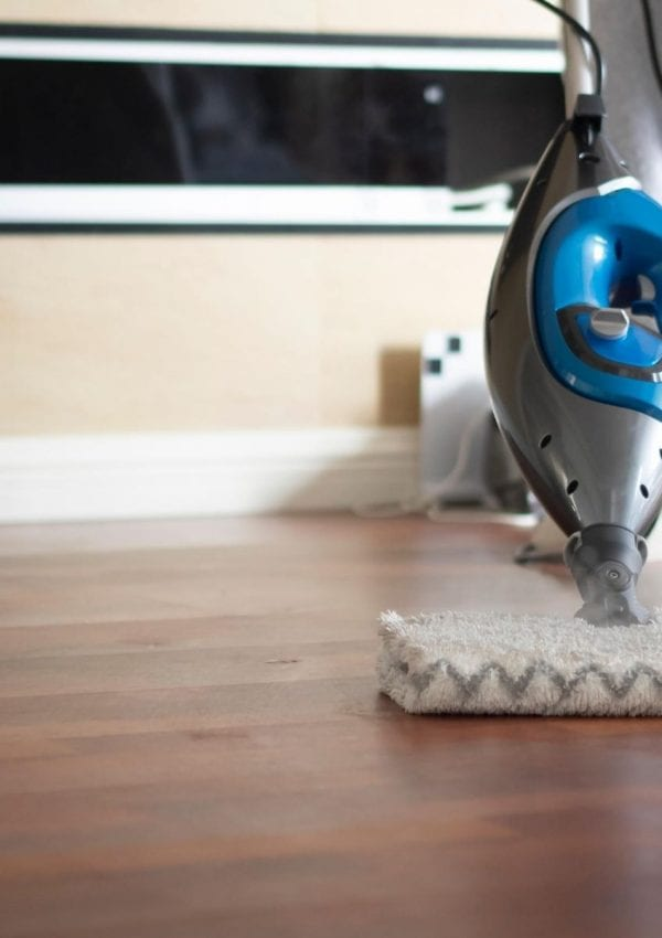 mopping the floor with a shark steam mop