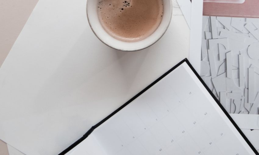 calendar and cup of coffee on a desk