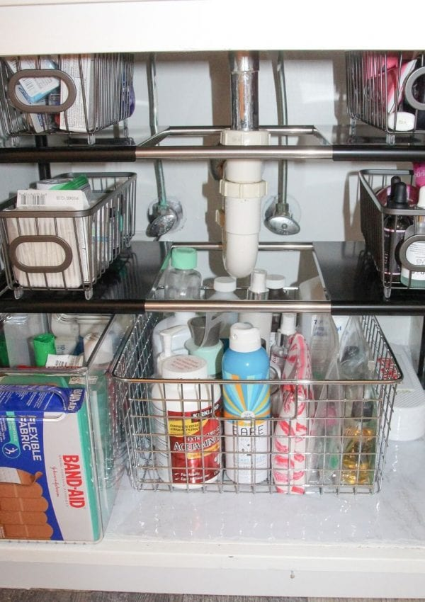 items under the bathroom sink organized in baskets