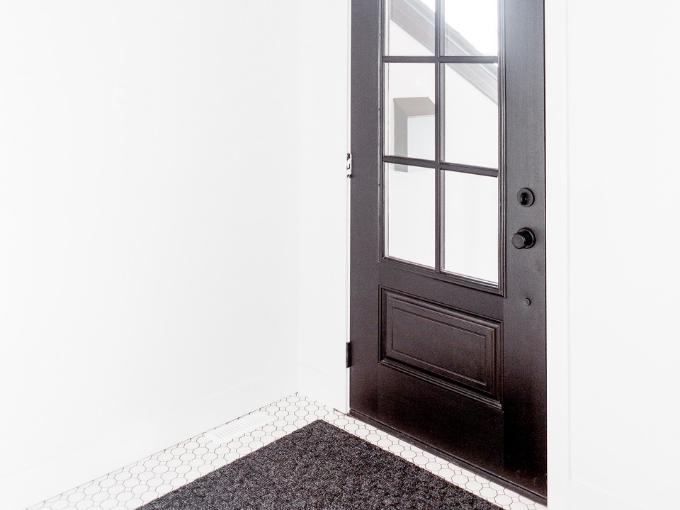 front door with white walls