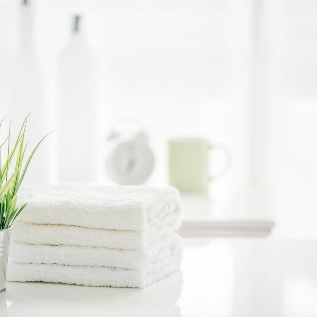 clean white towels on a bathroom counter