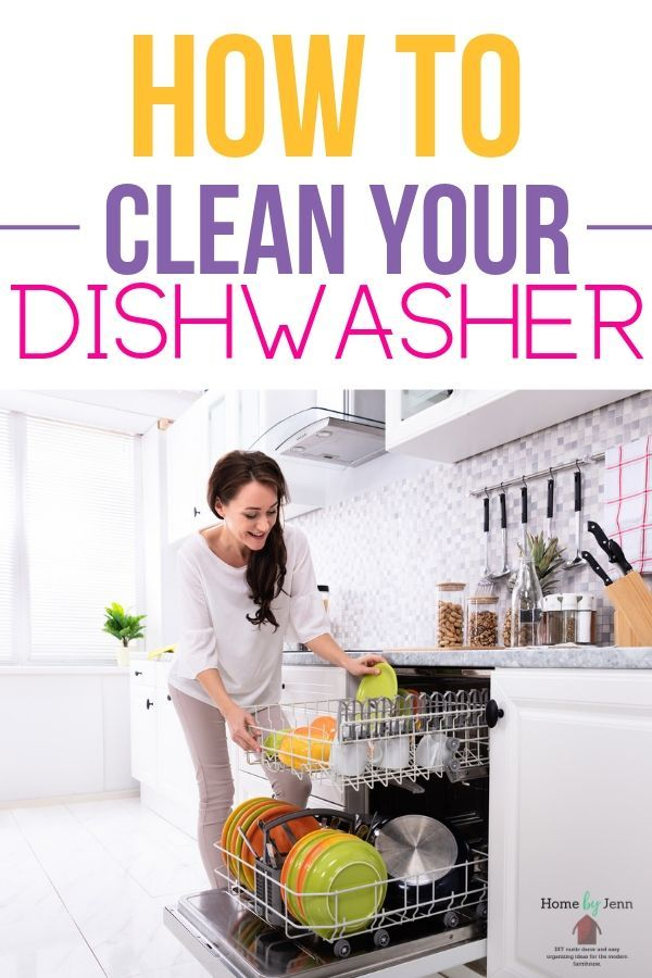 a women removing dishes from dishwasher