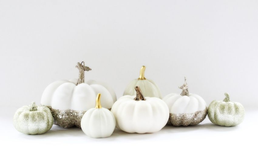White pumpkins with glitter bottoms.