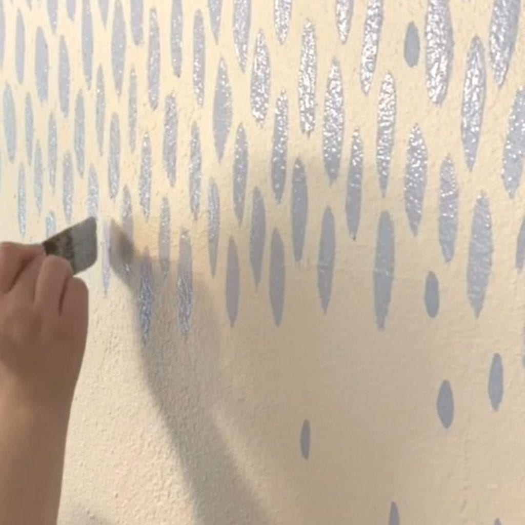 adding blue marks to the accent wall
