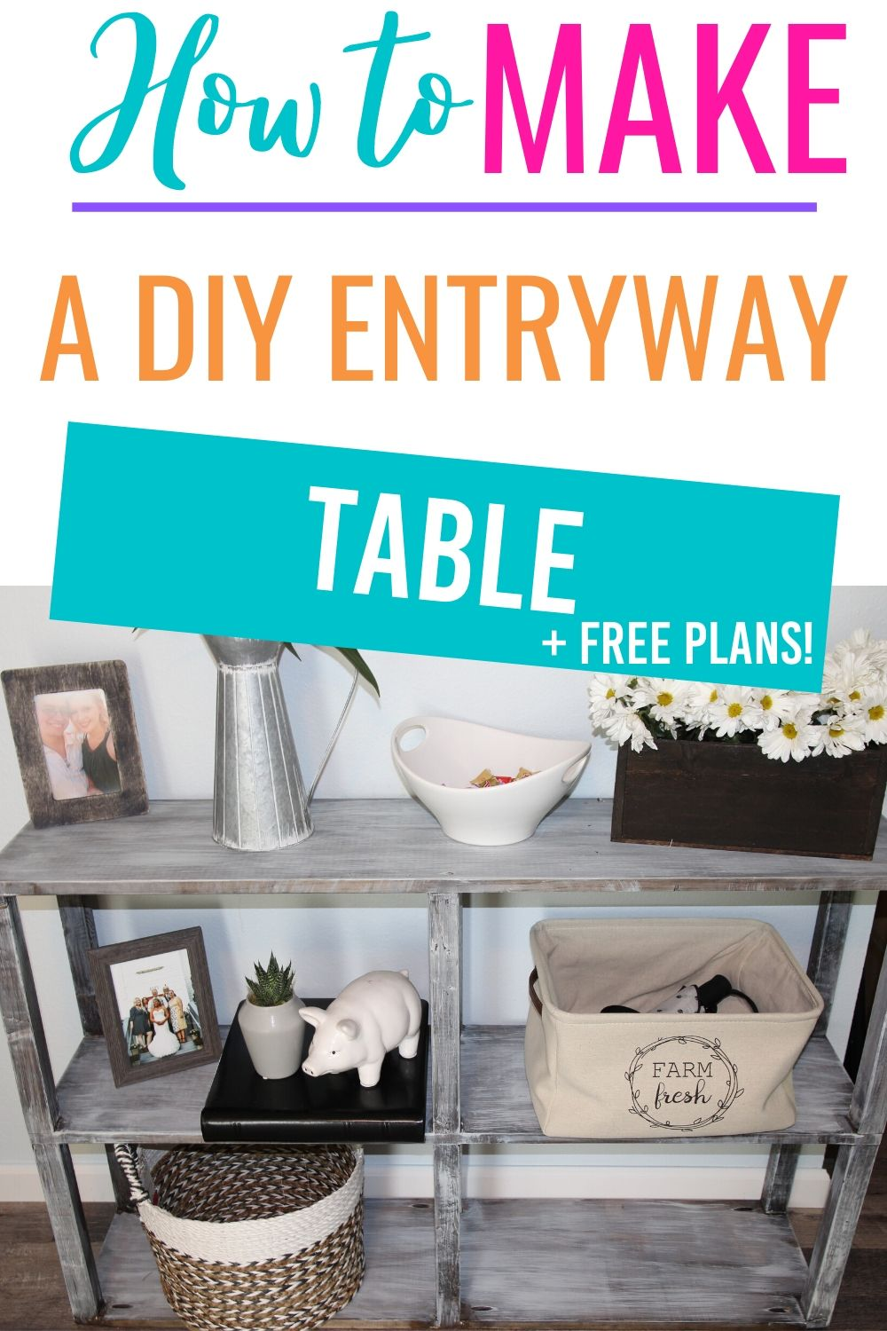 entryway table with flowers and other decor via @homebyjenn