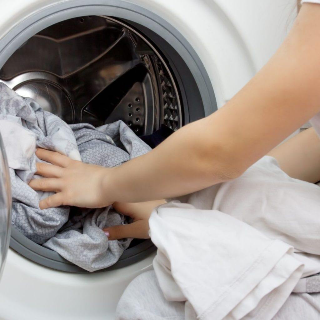 adding laundry to the front loading washing machine