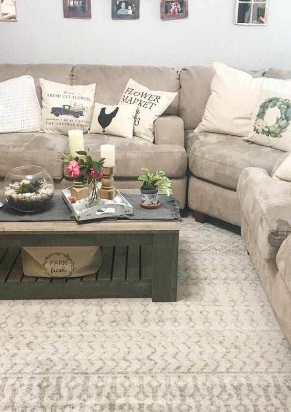 sectional couch with throw pillows and a coffee table