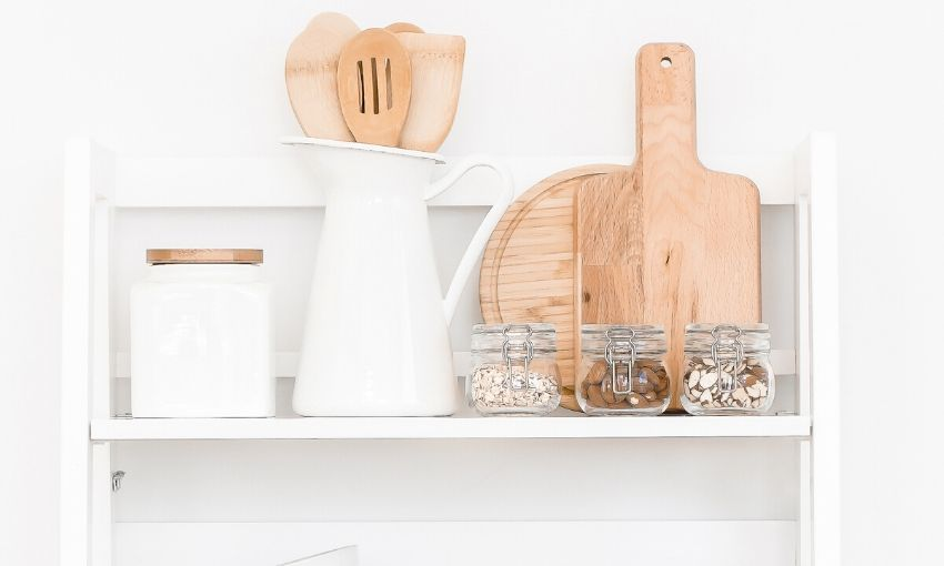 shelf of utensils and jars