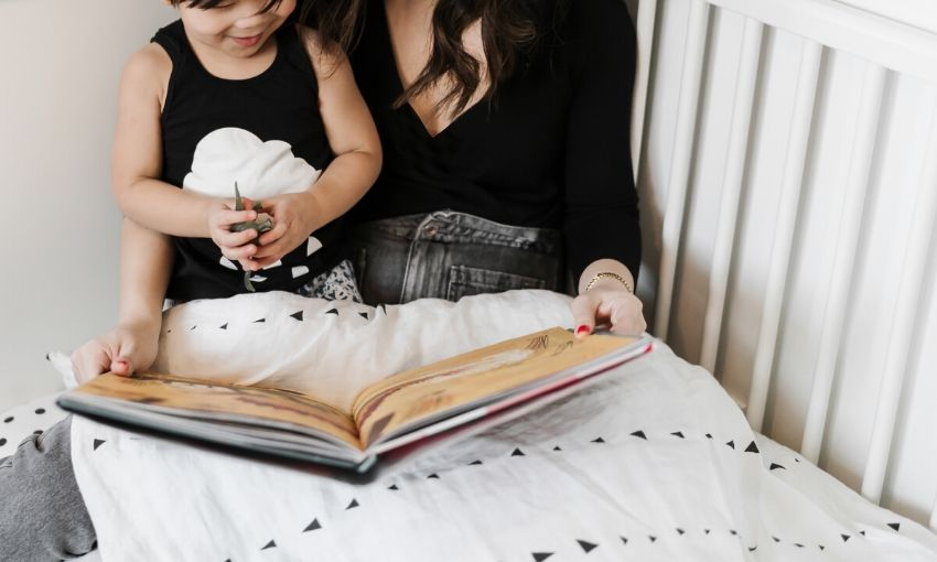 A mother reading a story to her child