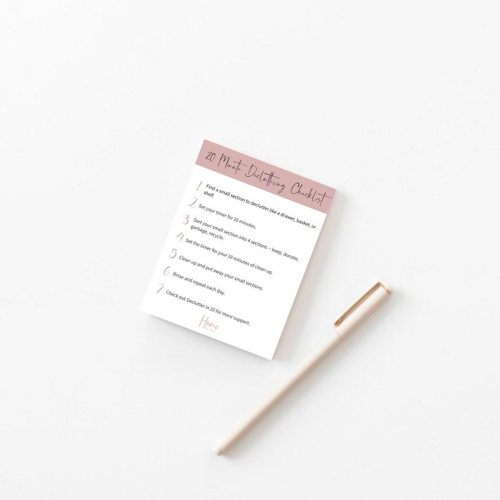 a decluttering checklist on a table and a pen.