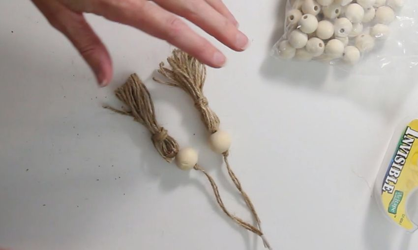 2 jute tassels with a single wooden bead on each tassel.