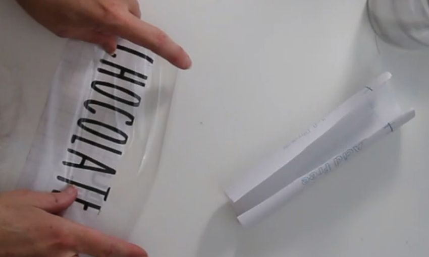 Attaching clear contact paper to the pantry label.