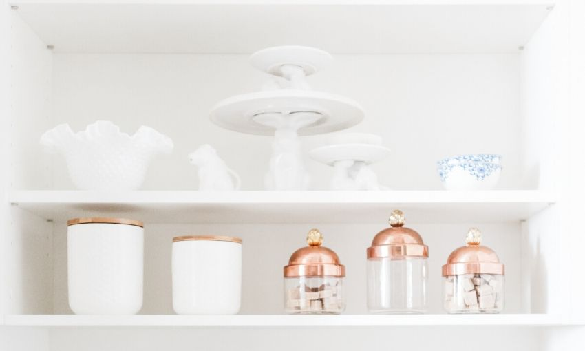 Shelves with containers, bowls, and cake stands.