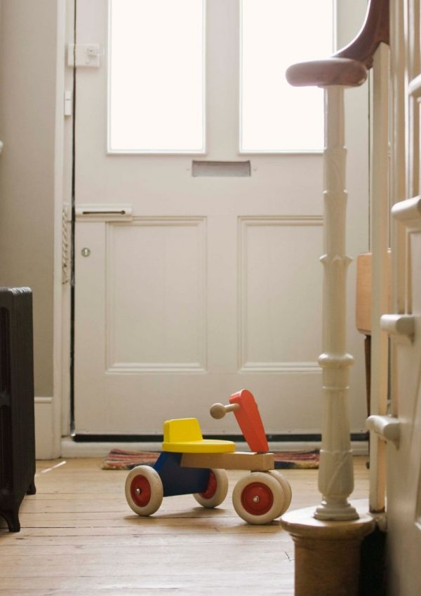 Entryway with a toy on the floor