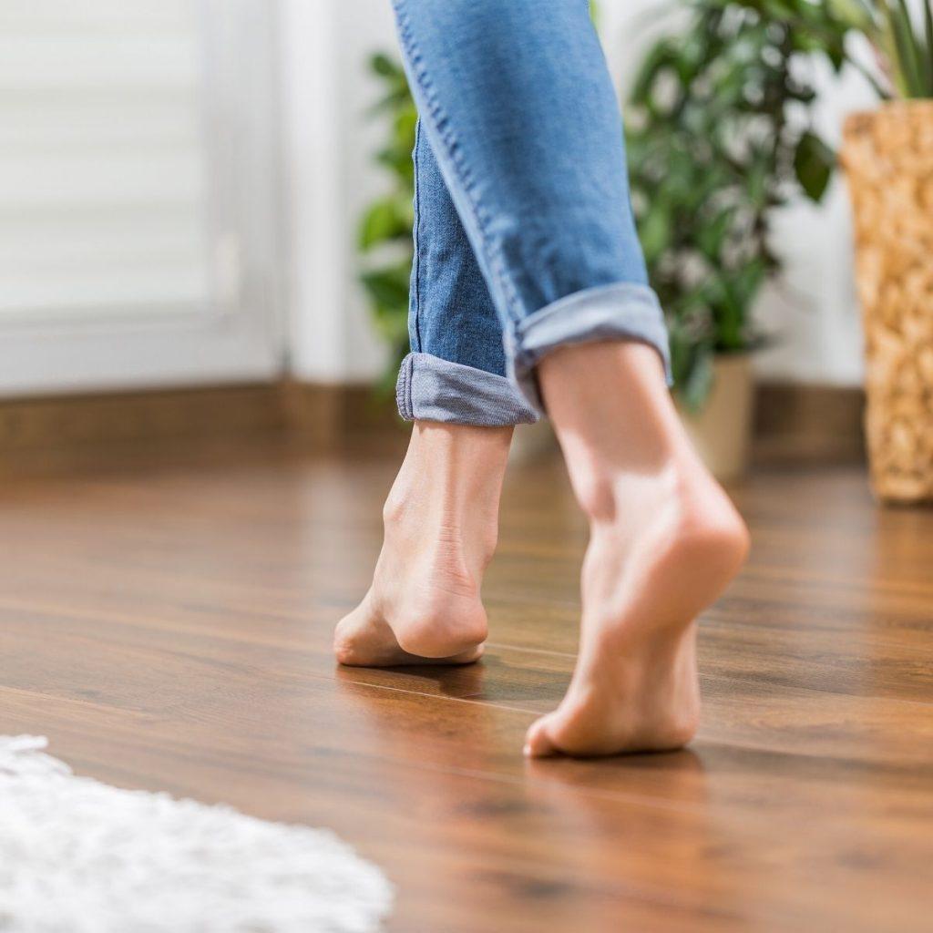 bare feet walking on a wood floor