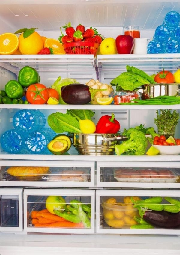 deep clean refrigerator filled with fruits and vegetables