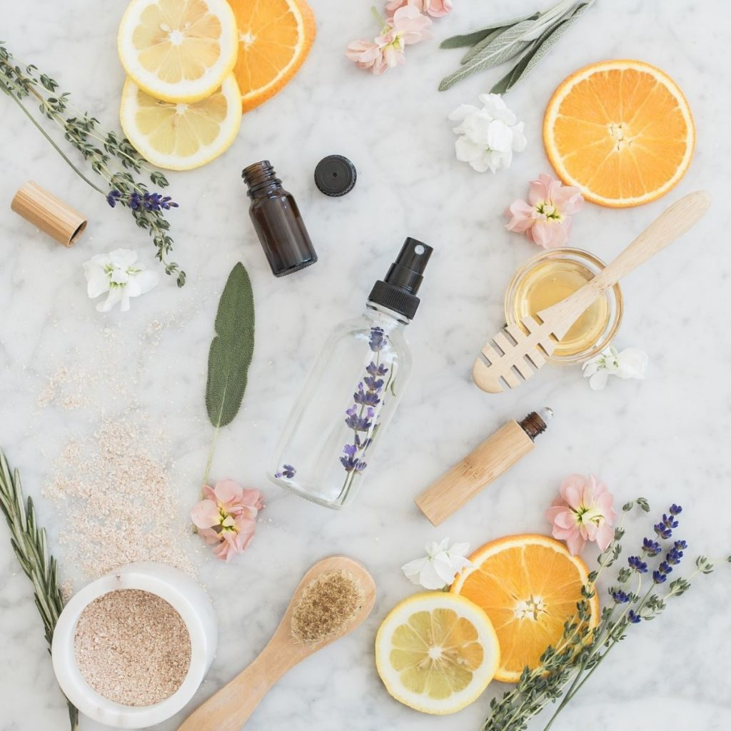 diy room spray on a counter with lemons and oranges and lavender