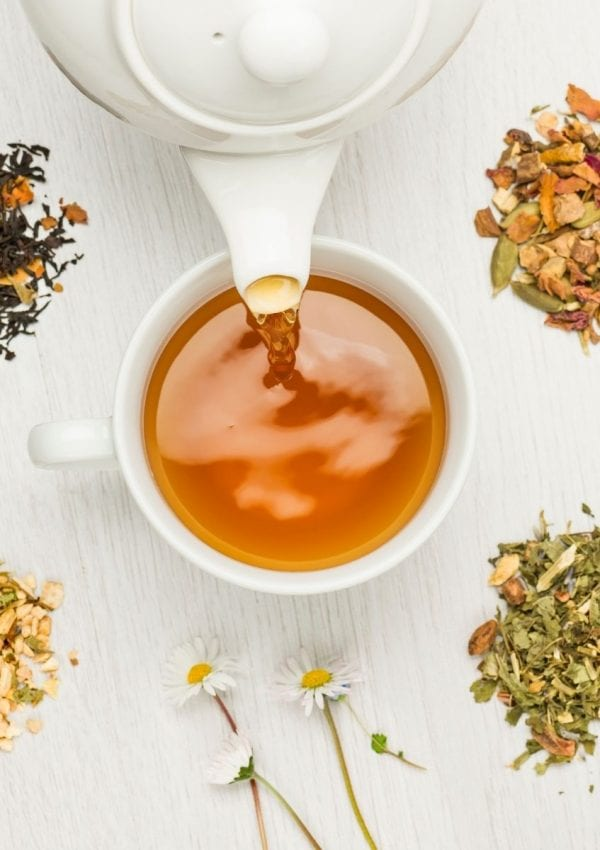 pouring a cup of tea for my fall morning routine.