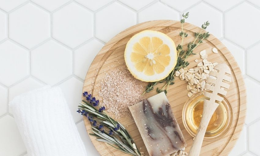 lemon, honey, herbs, and soap on a table