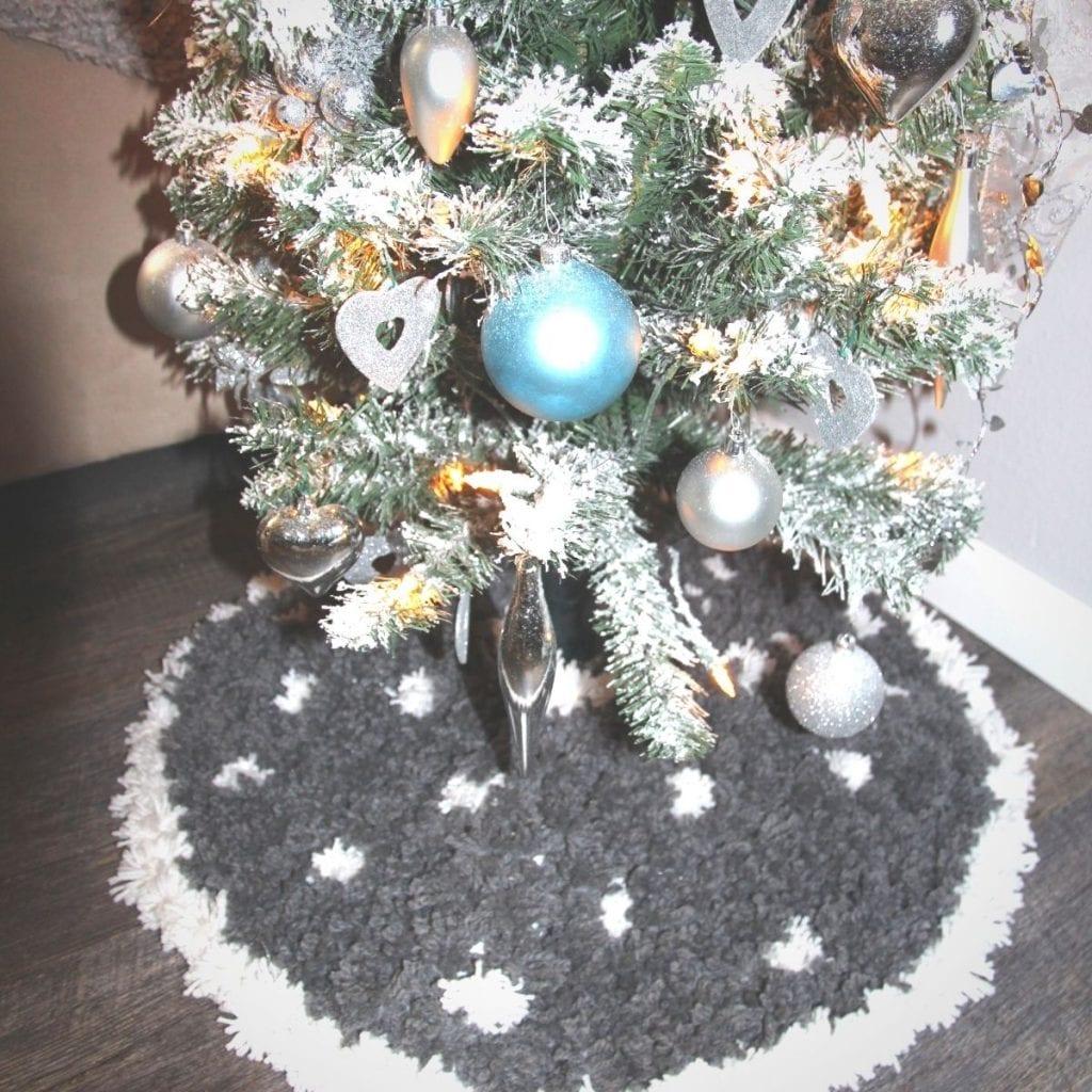 DIY Pom Pom Tree Skirt at the bottom of a Christmas tree