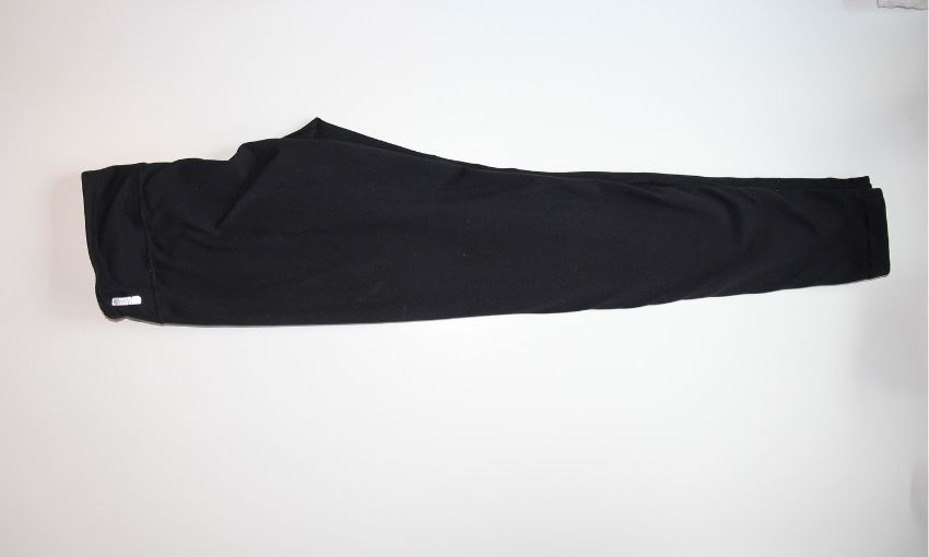 lay pants flat folded in half