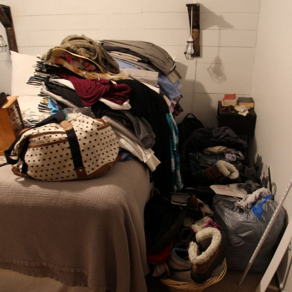 remove everything from the closet and placed on the bed