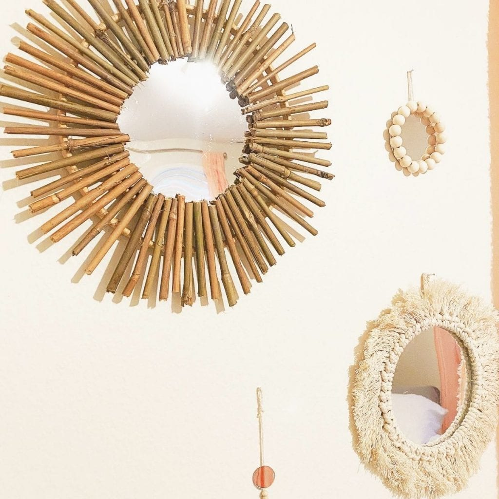 4 diy wall mirrors hanging on the wall.