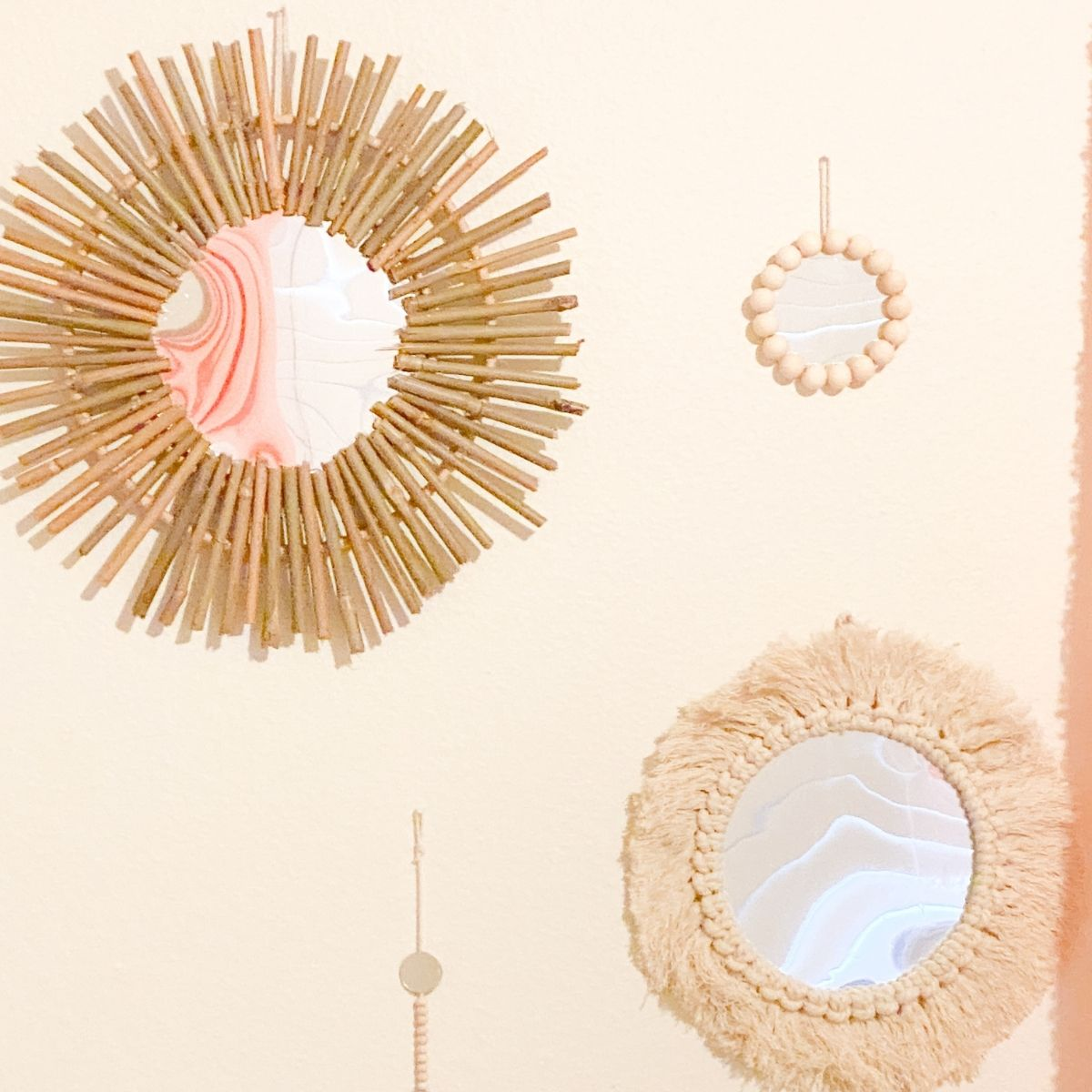 3 wall mirrors hanging on the wall