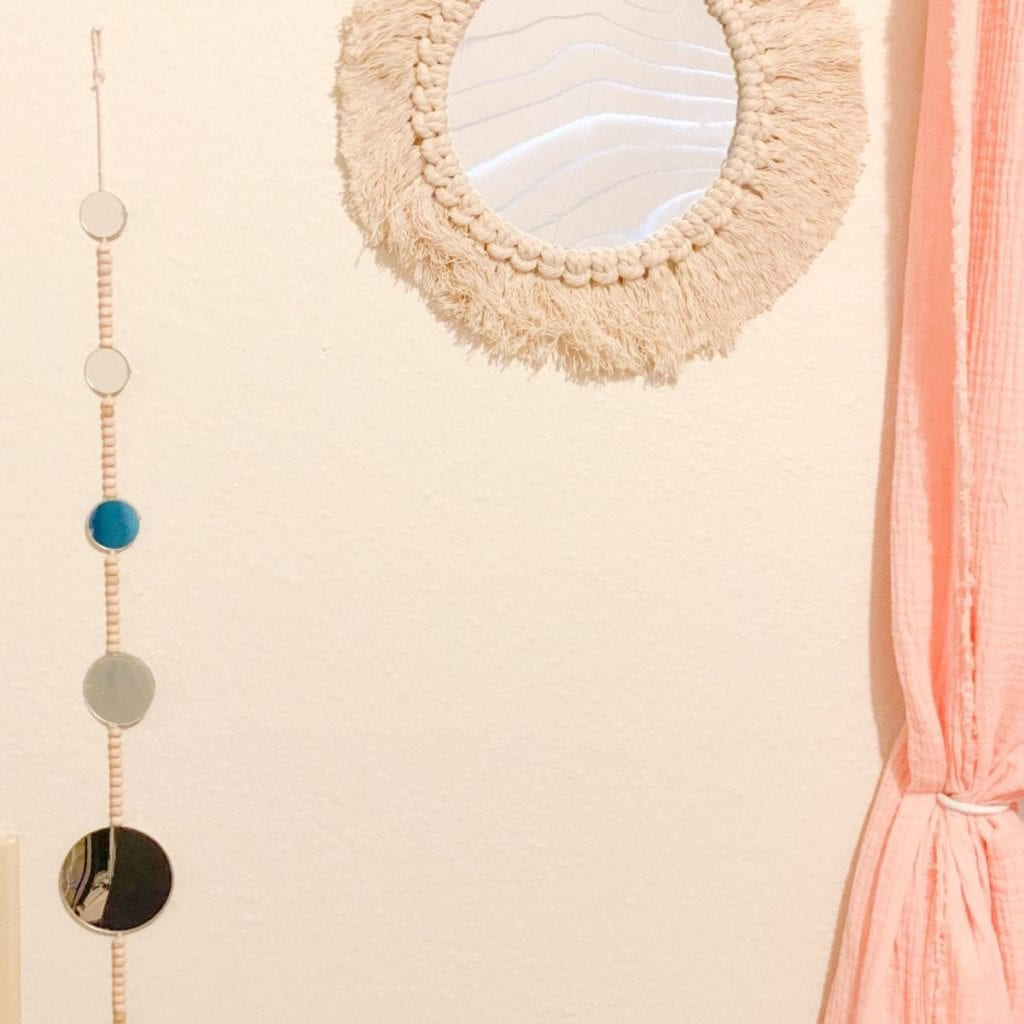 string of small wall mirrors hanging on the wall