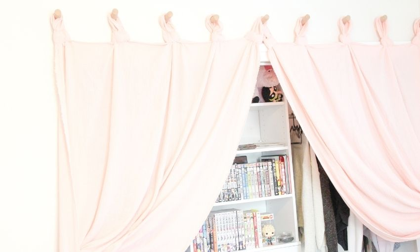 curtains hanging on the dowels over the closet