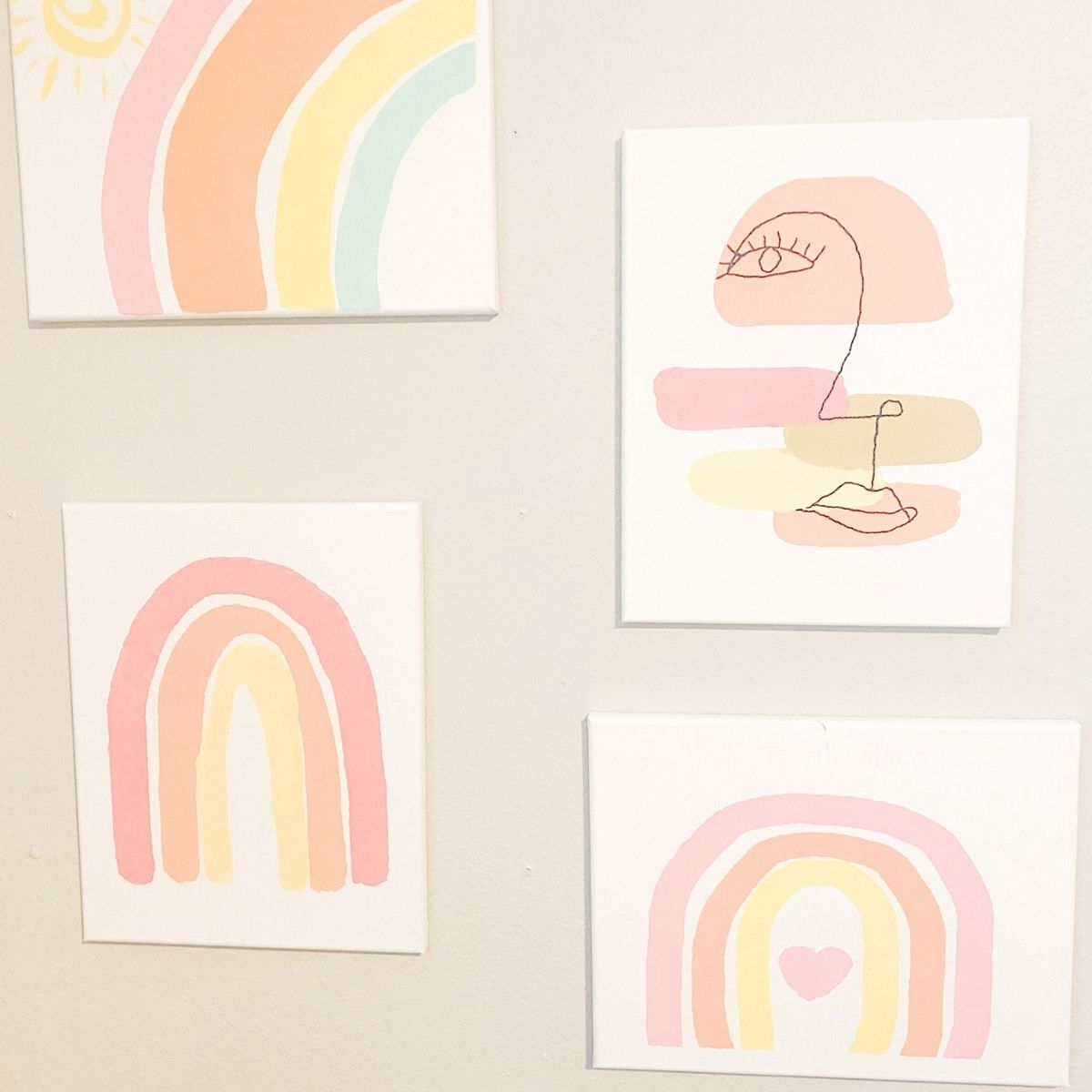 4 DIY abstract canvas paintings hanging on a wall