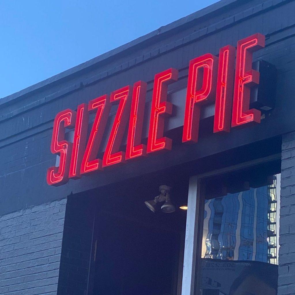 Sizzle pie the restaurant sign