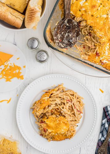 Baked chicken spaghetti on a plate ready to eat.